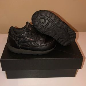 Black/Gold Leather Reebok..Size 4..